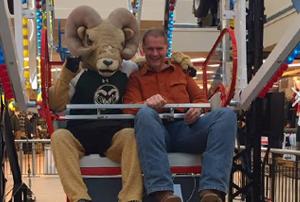 CSU mascot rides along with Scott James.