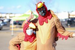 Two Food Bank team members dressed as Thanksgiving turkeys.