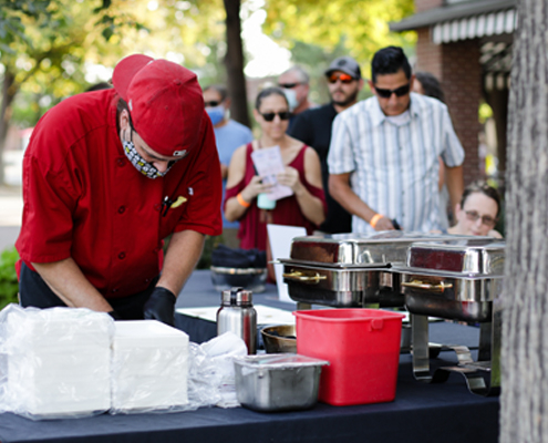Chef prepares a plate at The Taste Walkabout.