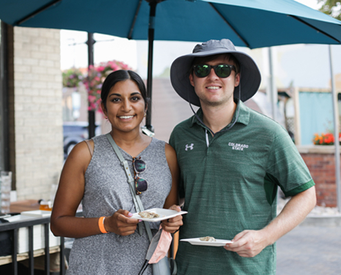 A couple enjoys the food at The Taste Walkabout.