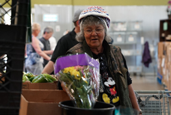 Food Bank client picks out flowers.